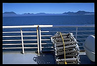 Chairs stacked on the deck of an Alaska Marine Highway ferry.